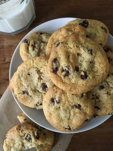 Gluten-free chocolate chip cookies with a glass of milk
