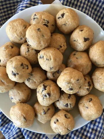 Peanut butter protein balls with chocolate chips on a white plate