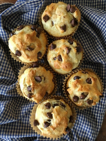 Chocolate chip muffins on a blue and tan plaid napkin