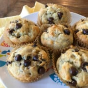 Six banana chocolate chip muffins in paper liners