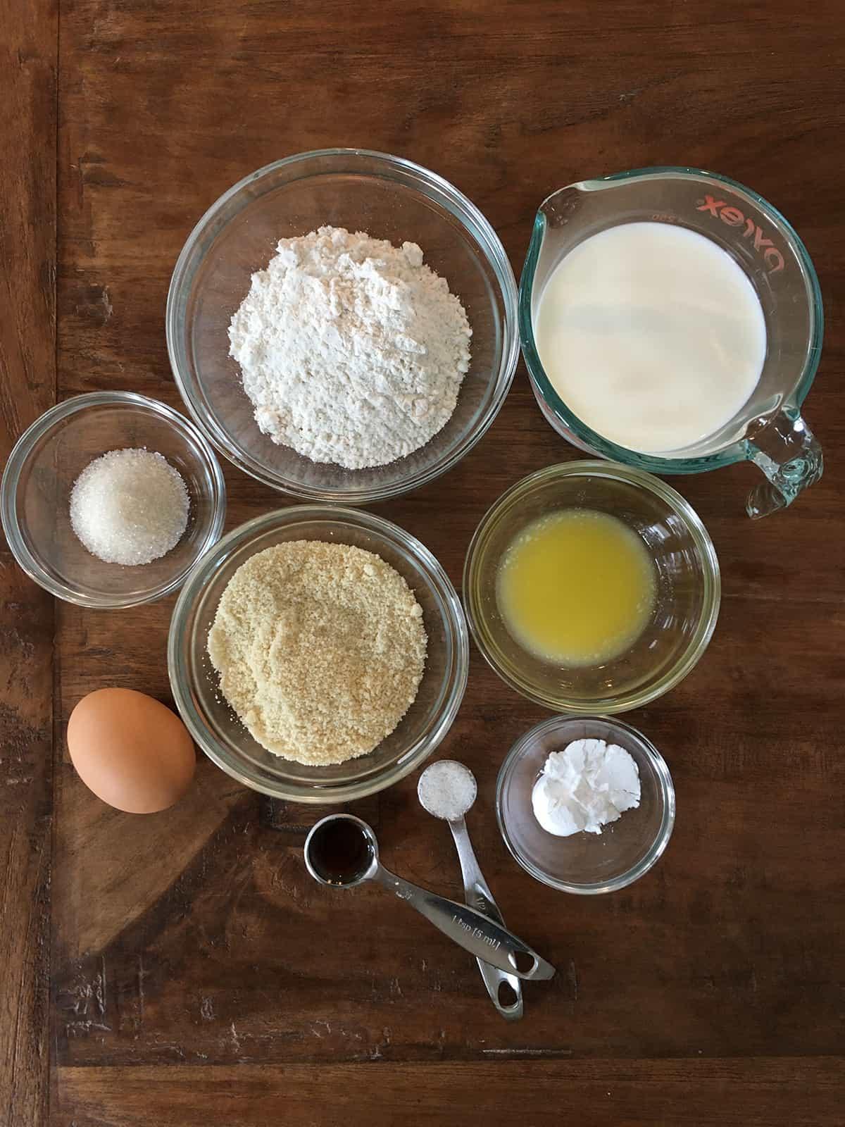 Pancake ingredients on a brown wood table