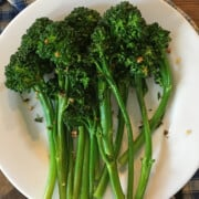 Sautéed broccolini with garlic on a white plate