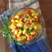 Mango salsa in a glass bowl